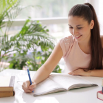 pretty-student-girl-studying-at-table-with-books_417ynzssg__F0000